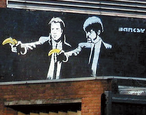 Banksy's famous Pulp Fiction Piece where John Travolta and Samuel L Jackson are holding bananas instead of guns located near Old Street station, London, Uk